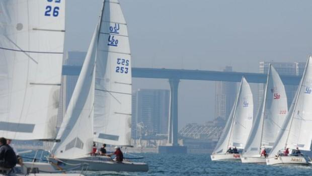 Jim Ulatowski's Juiced! (far right), with Coronado Bridge and downtown San Diego in the background, heads to the right side of the course after the start.
